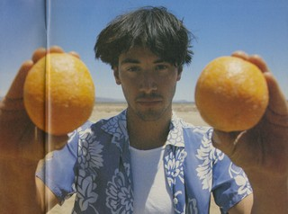 Keanu Reeves in i-D magazine 1993 holding oranges