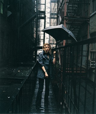 Natasha Lyonne in i-D magazine with umbrella in the rain