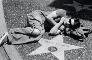 Emile Hirsch lying on Hollywood's Walk Of Fame at the star of Bela Lugosi