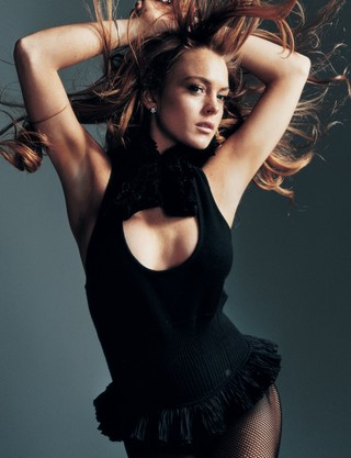 Lindsay Lohan with a bodysuit and wind machine and big hair