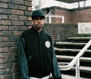 The History of Grime: Wiley in a black jacket and black baseball cap