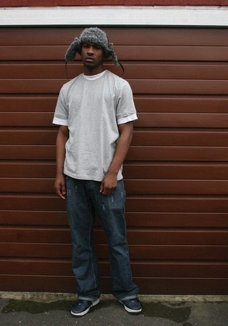 The History of Grime: Skepta in a grey hat and grey tshirt