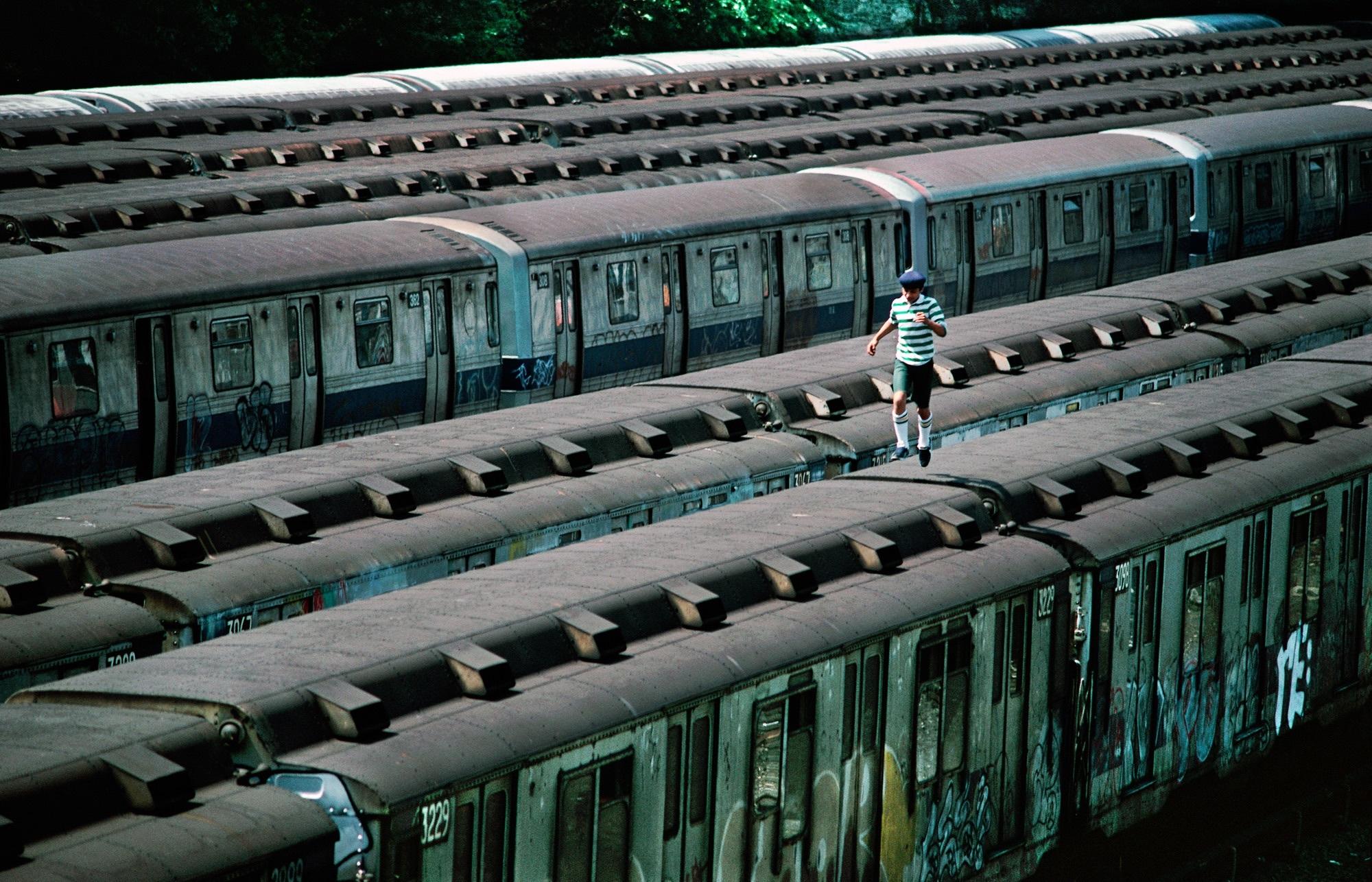Boy running on top of train 1982 copyright marthacooper courtesy steven kasher gallery new york