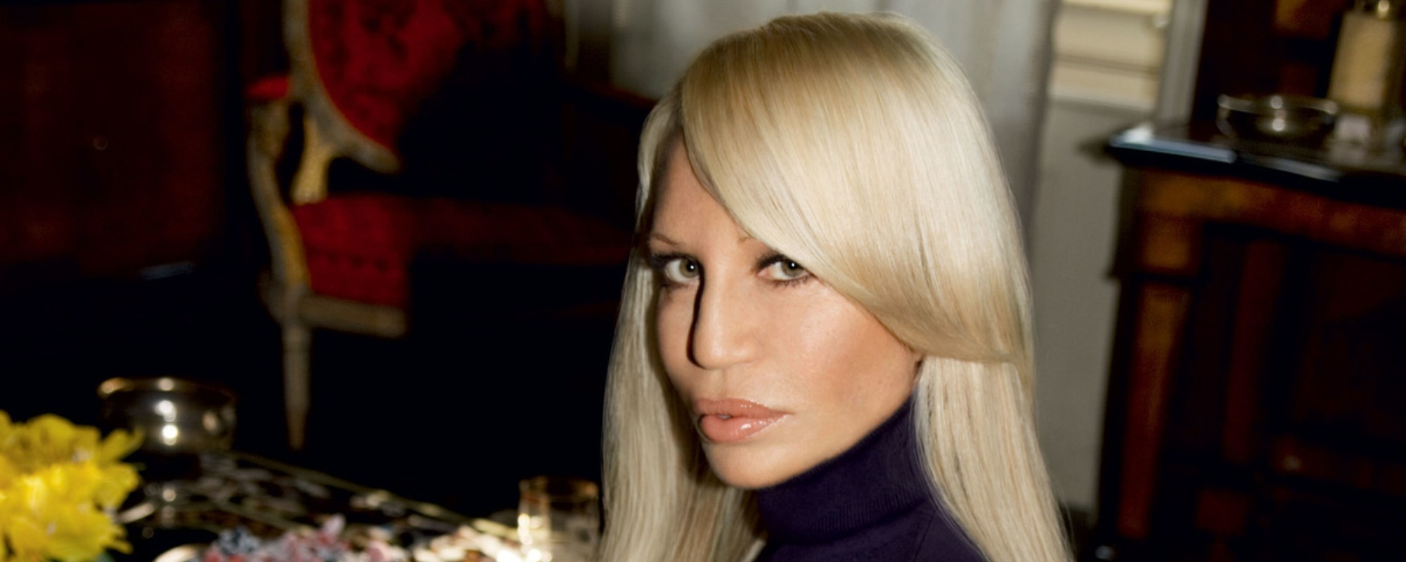 ​donatella challenges armani's comments on her brother gianni