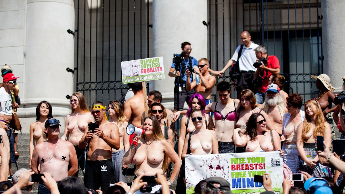 ​topless protestors take to times square