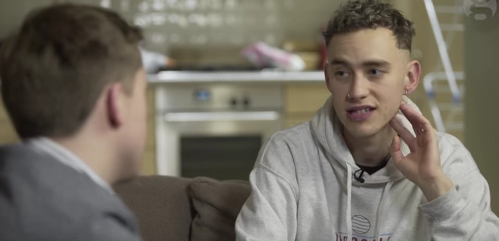 """olly alexander discusses mental distress and growing up gay """"in a straight world"""""""