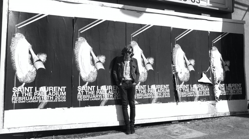 ​hedi slimane is suing yves saint laurent owner kering