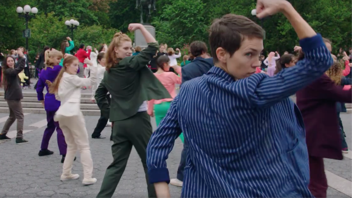 watch 200 dancers in pantsuits do a joyful flash mob for hillary