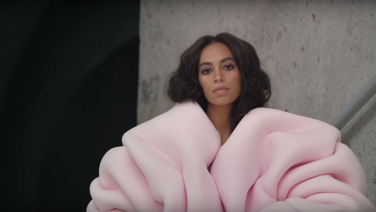 the designer behind solange's iconic pink 'cranes in the sky' sweater