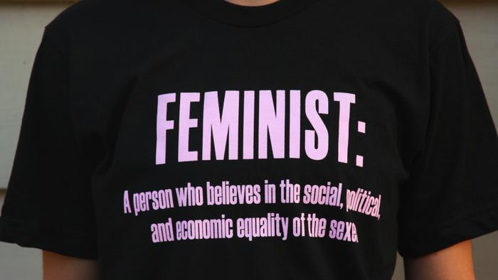 say it loud, I'm female and I'm proud: a debate for and against the feminist slogan tee