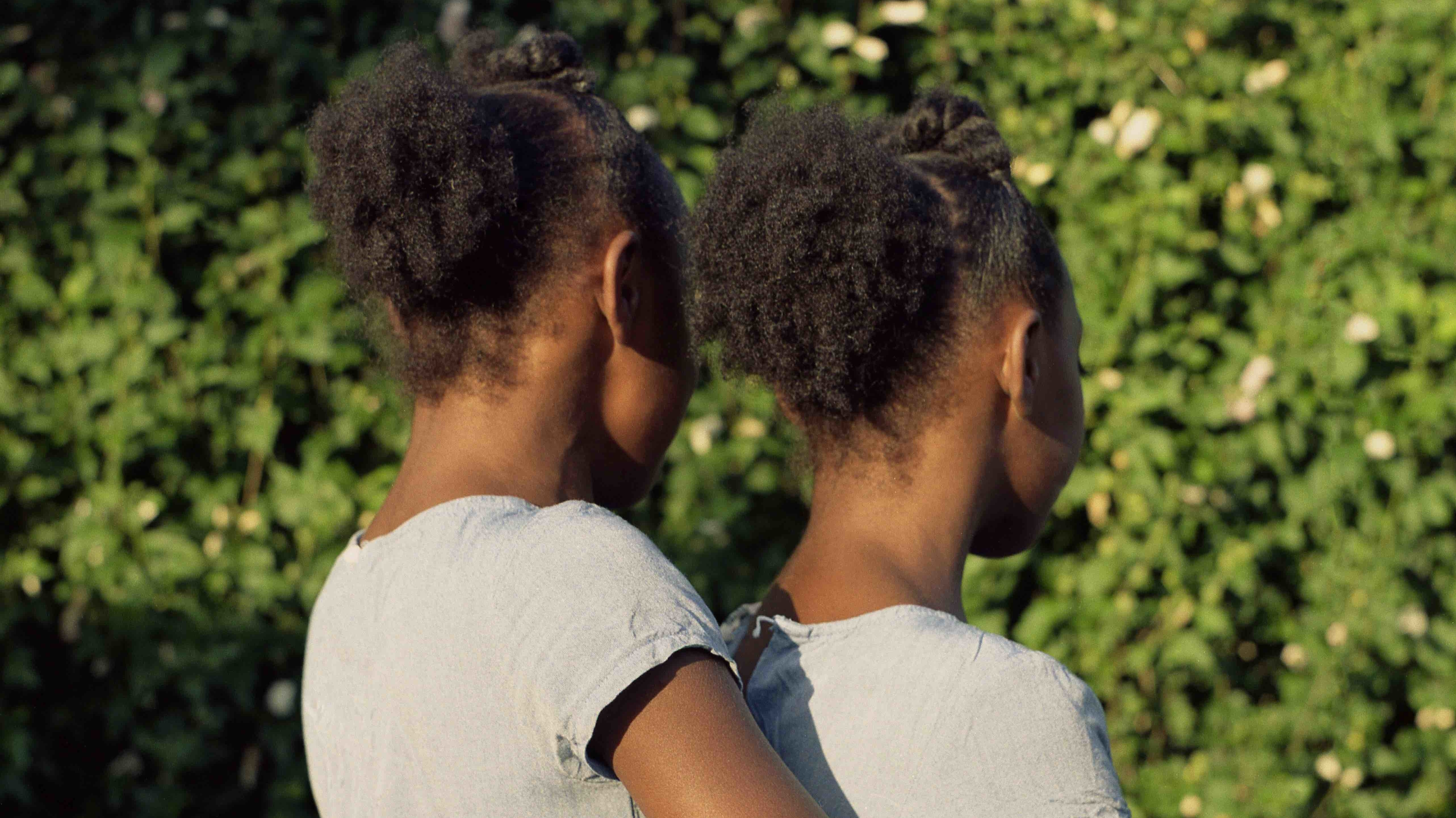 this photo series of black twins is about sisterhood and stereotypes