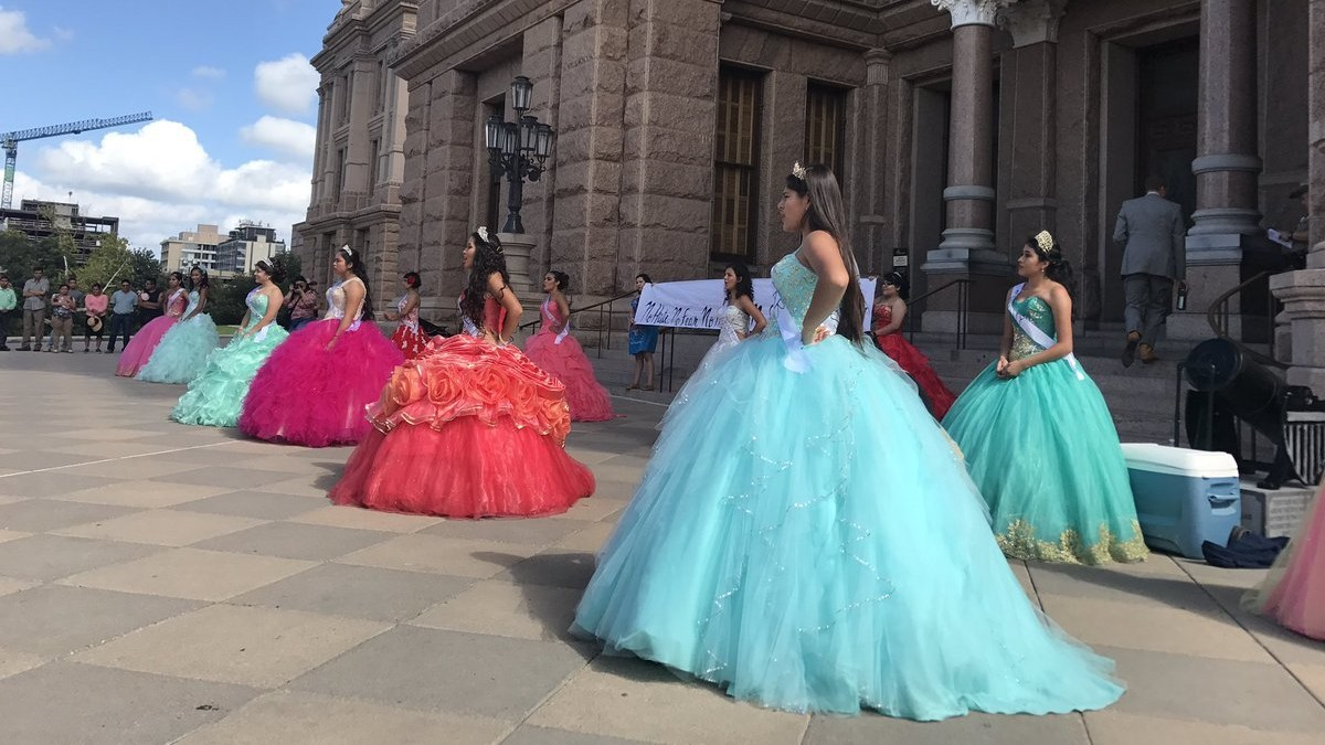 teens in quinceañera dresses protest texas immigration law