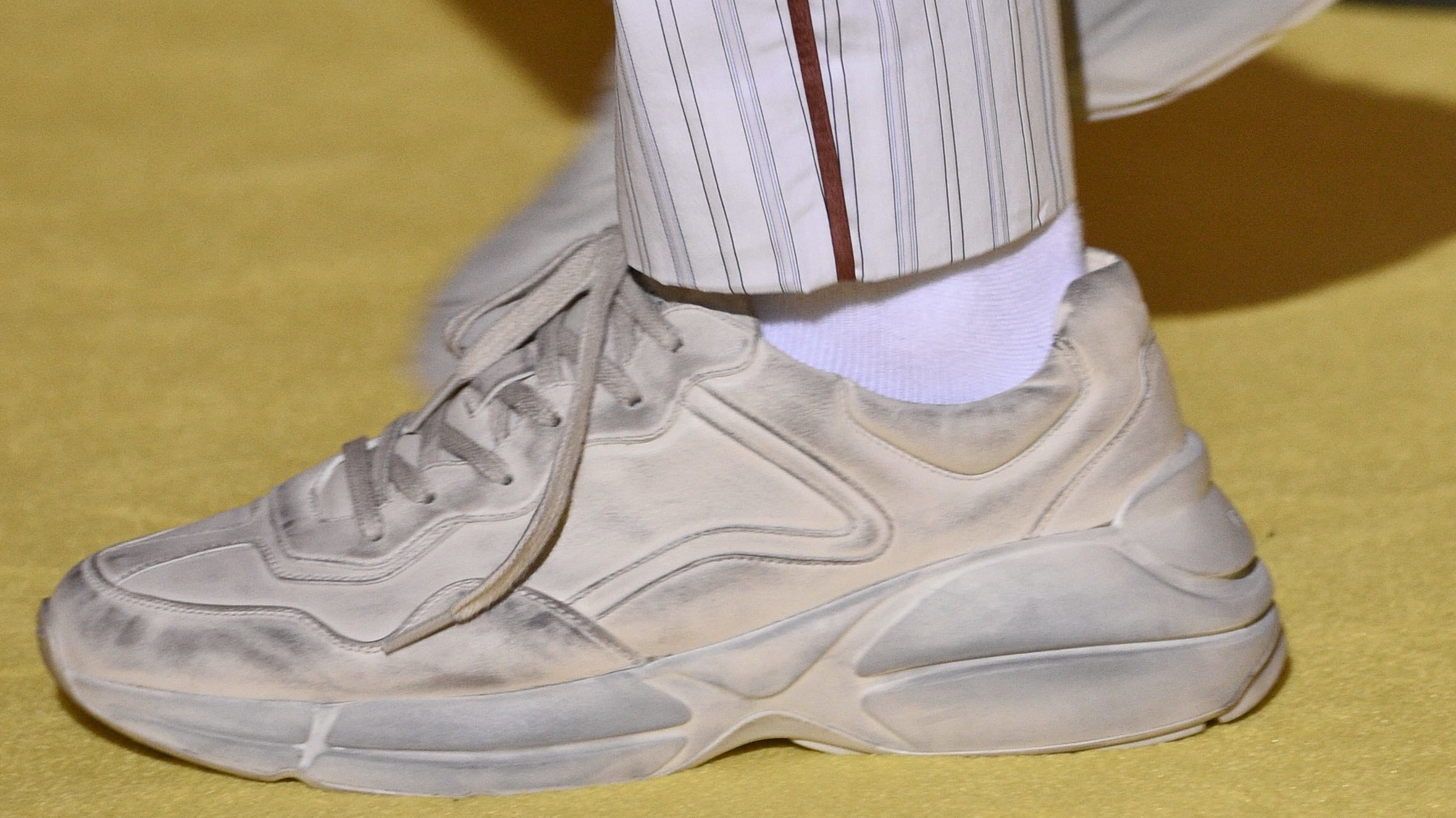 why designers are sending dirty sneakers down the runway
