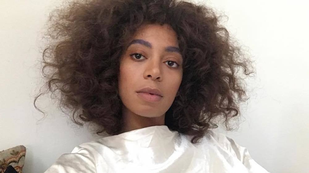 solange is signing books at a pop-up in bed-stuy